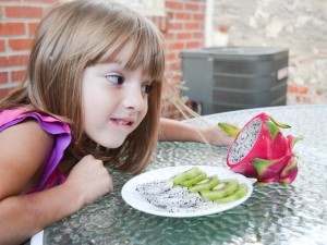 20140915-child-eying-fruit-sarah-grey