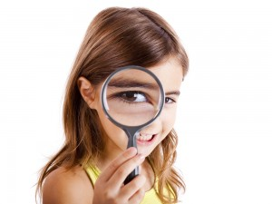 little-girl-looking-magnifying-glass_shutterstock_64244332